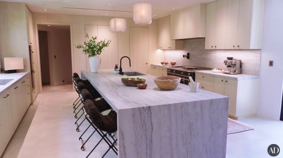 Another image of their spare kitchen, with a long island table