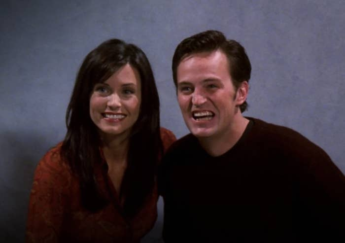 Monica and Chandler are posing for an engagement photo