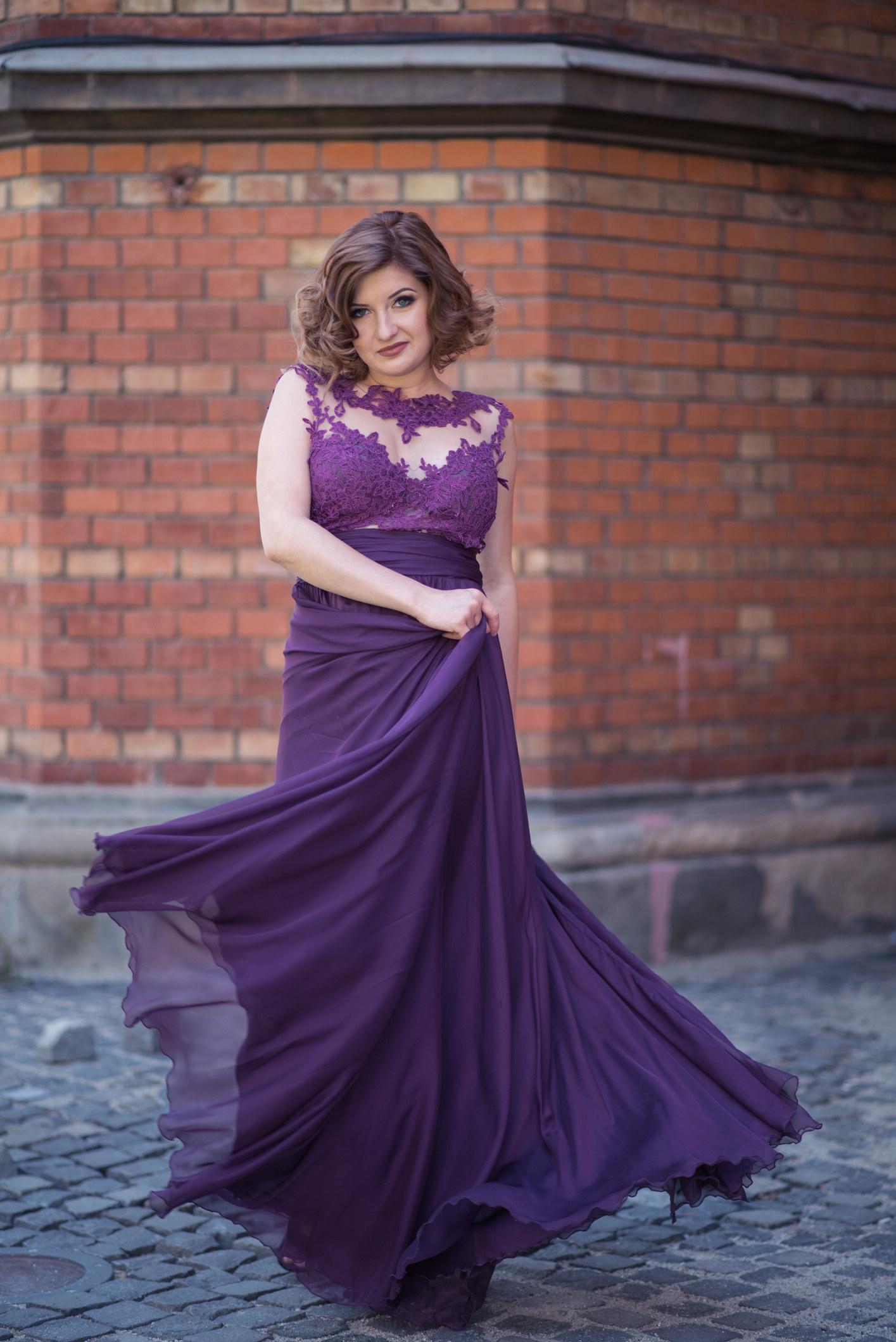 photo of woman in a purple dress