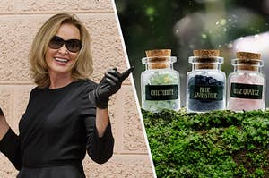 Fiona Goode from AHS Coven pointing at some crystals in magical jars
