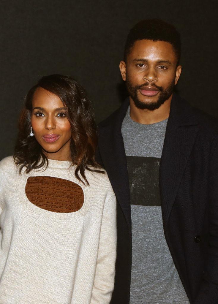 Washington and Asomugha pose for a photo at a premiere event