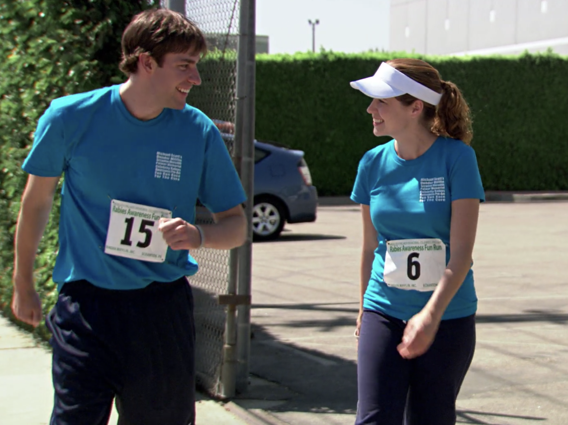 Jim and Pam are walking with each other at the Rabies Fun Run