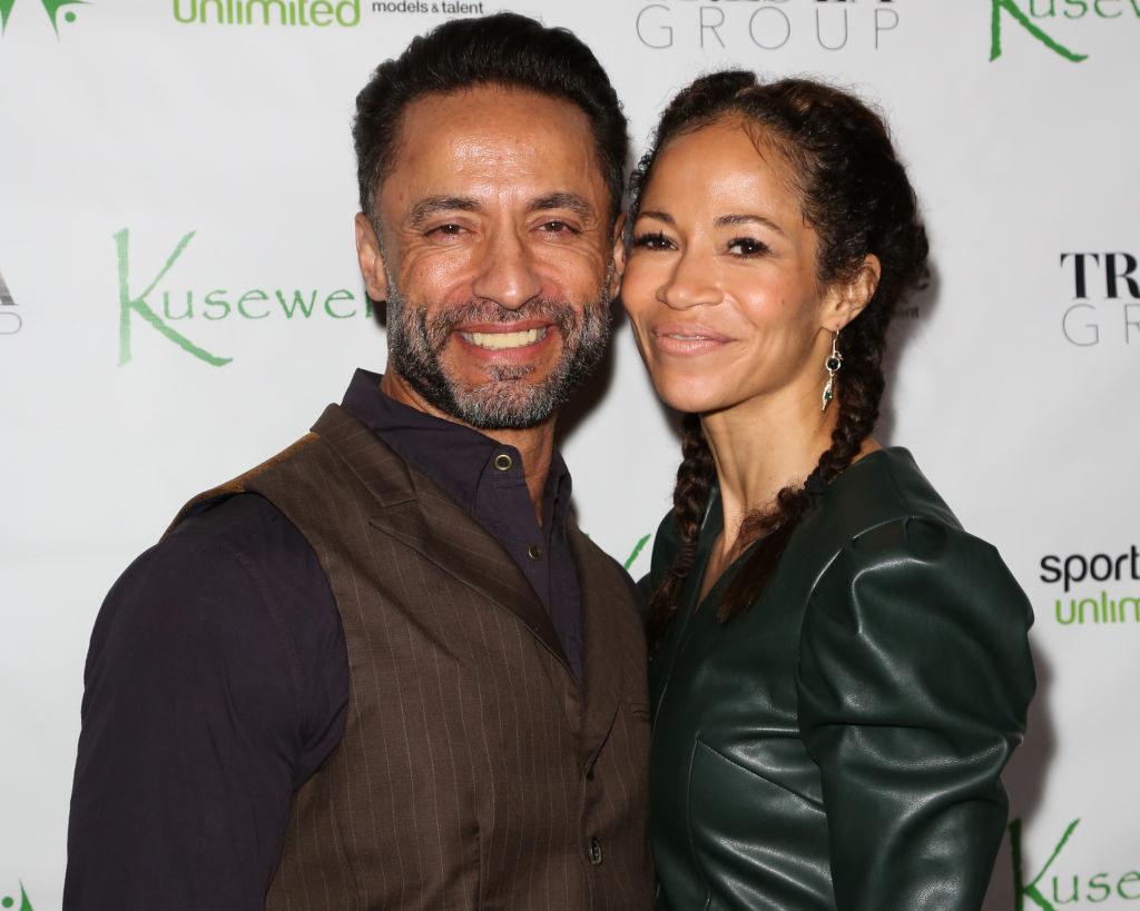 Sherri Saum is posing with her husband Kamar de los Reyes
