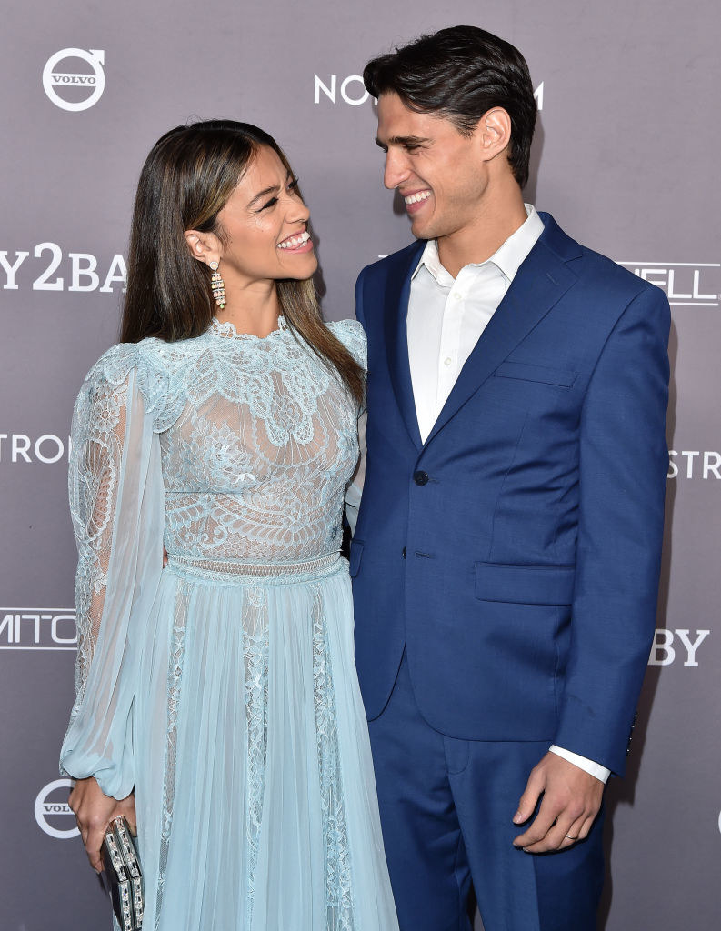 Gina smiling with Joe at a gala