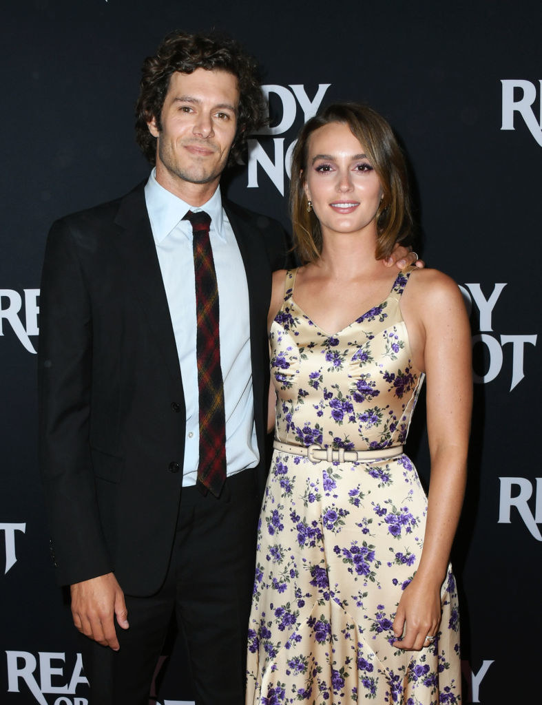 Leighton is with Adam at a premiere event