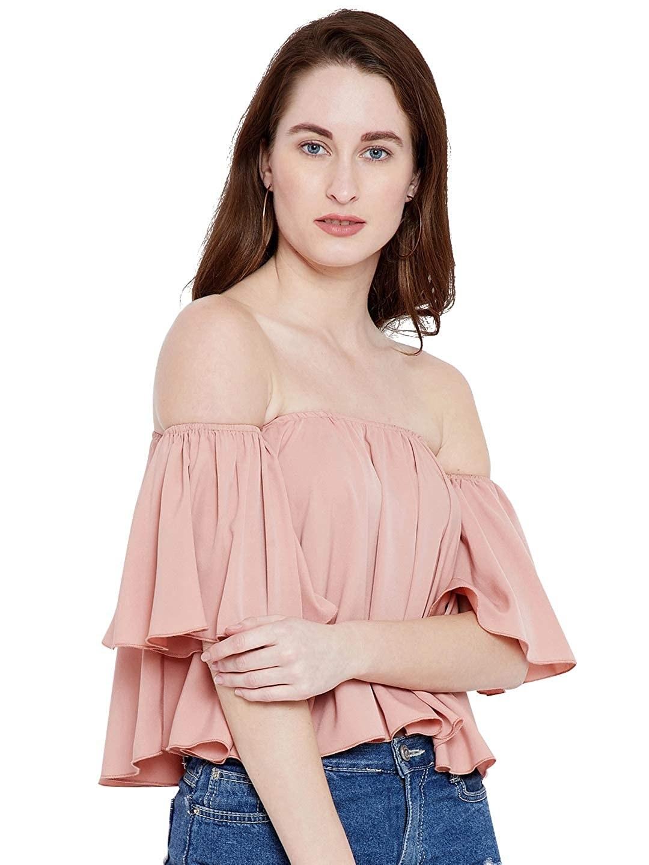 A pink, ruffled off-shoulder top