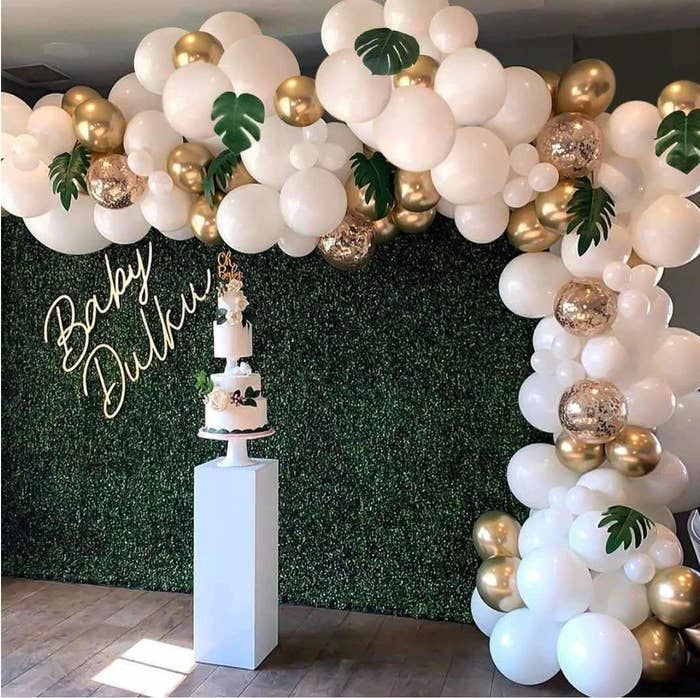 A balloon garland made from white and gold balloons