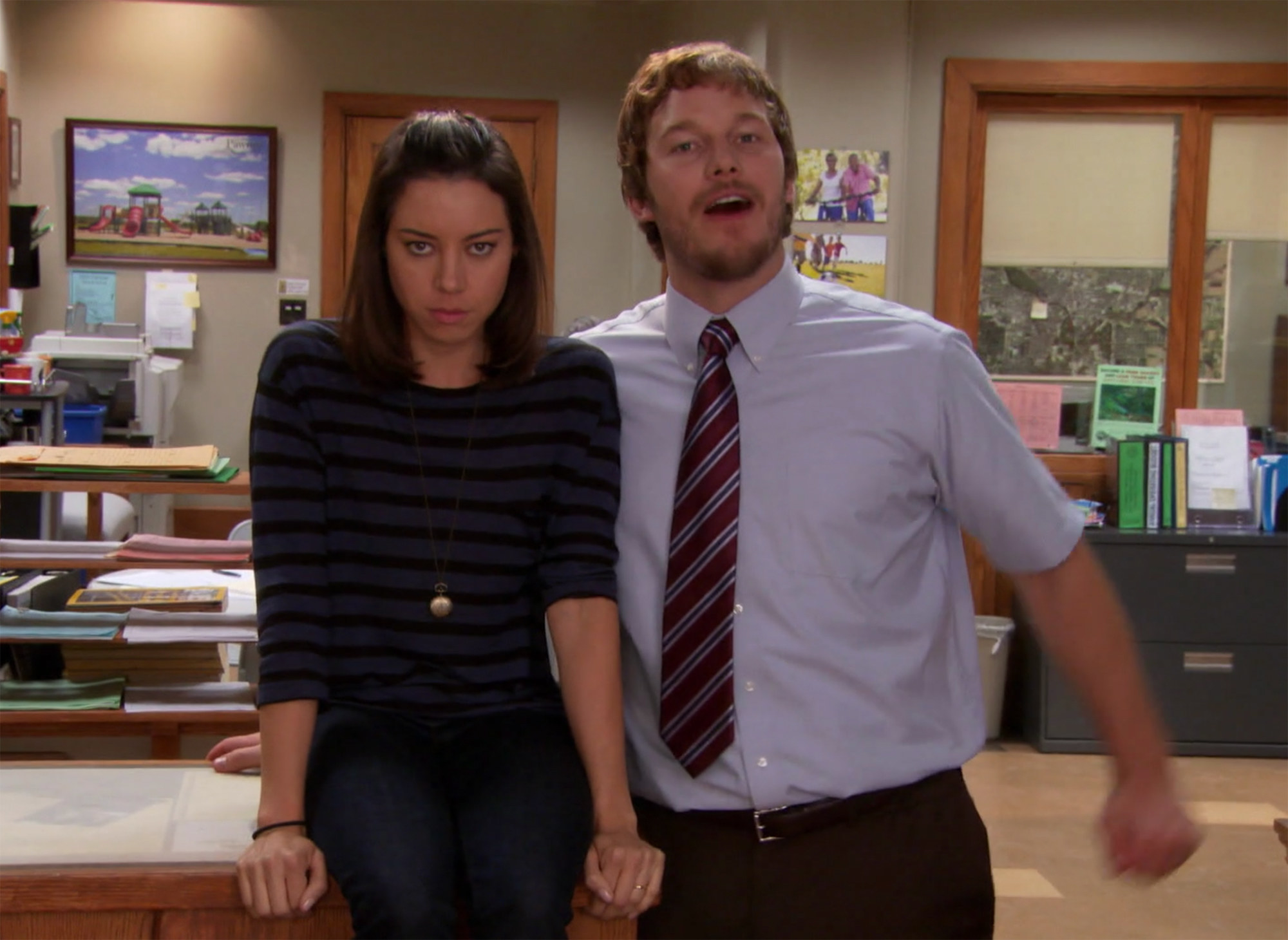 April sitting on a desk next to Andy