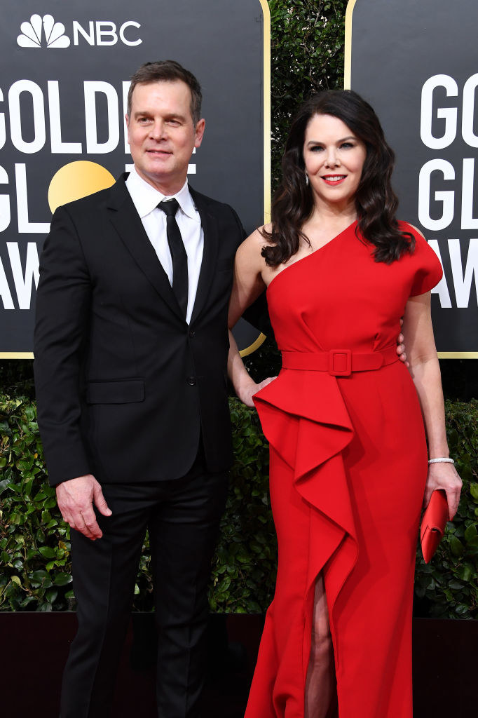 Graham and Krause posing for photos at the Golden Globe Awards