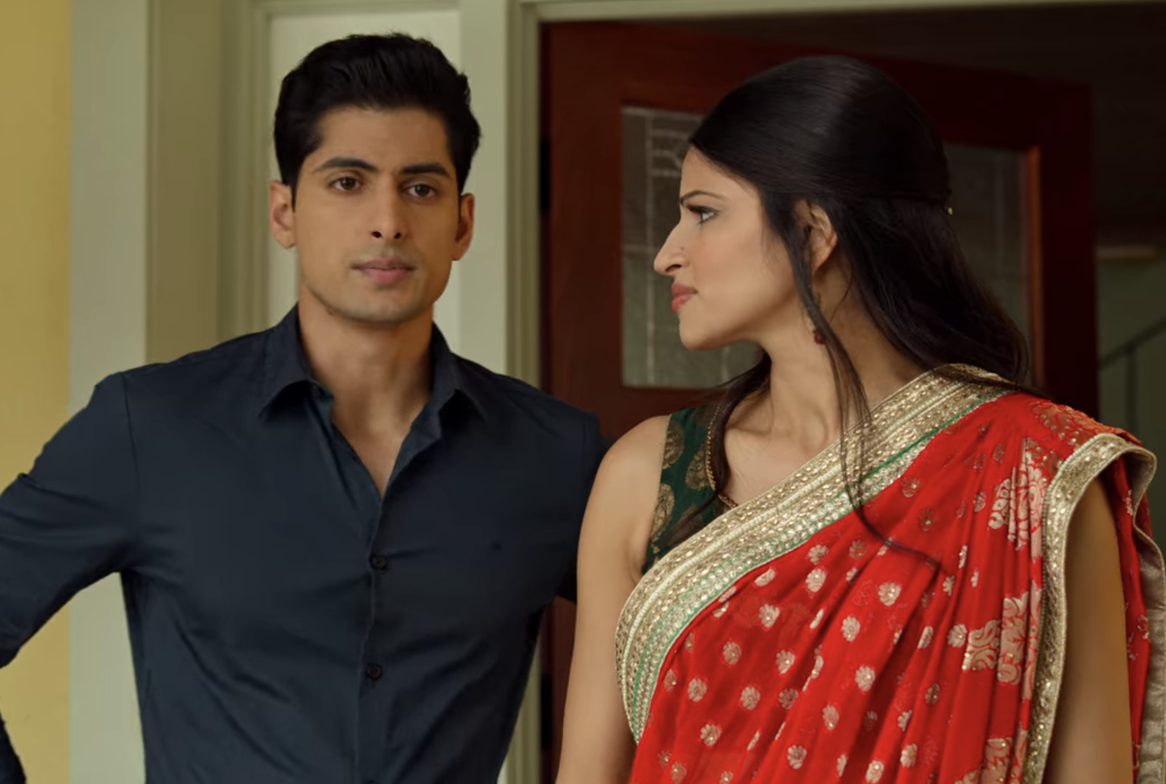 Kamala looking at Prashant, who is standing next to her