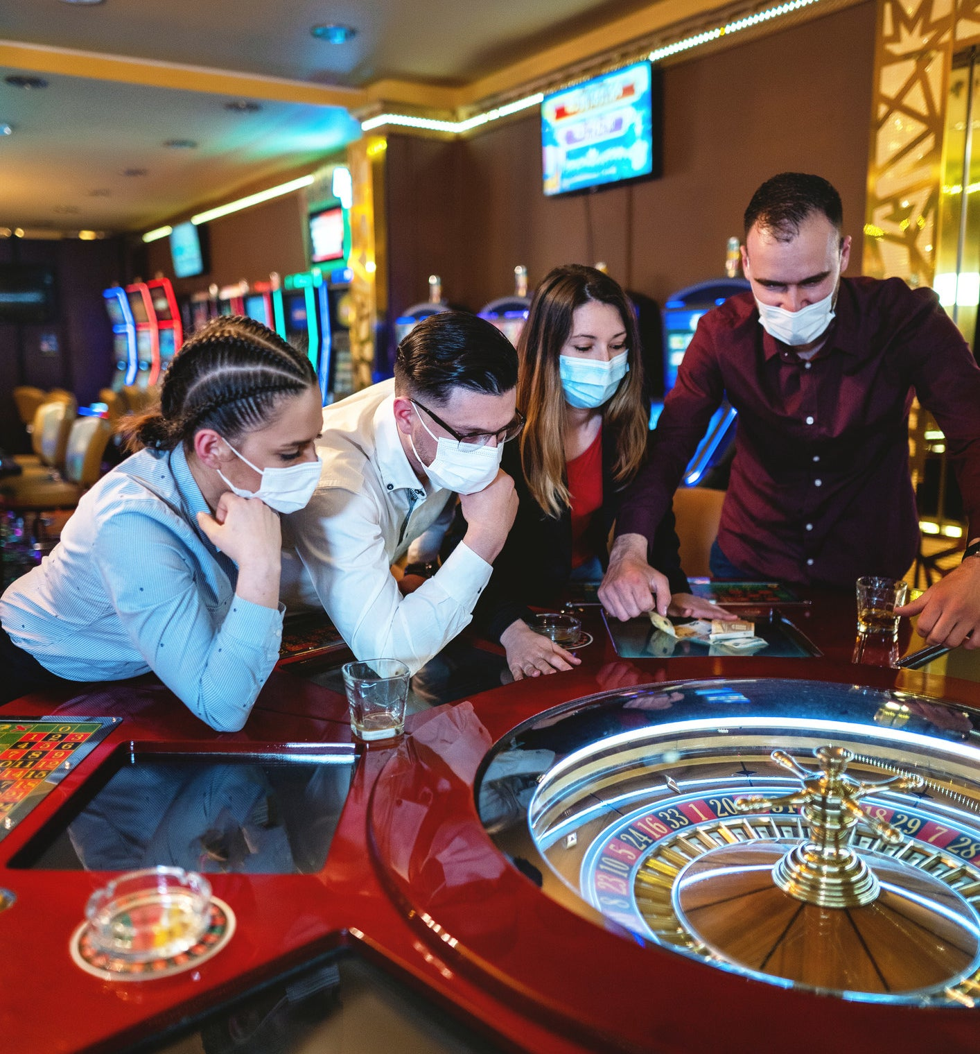People standing around a craps table