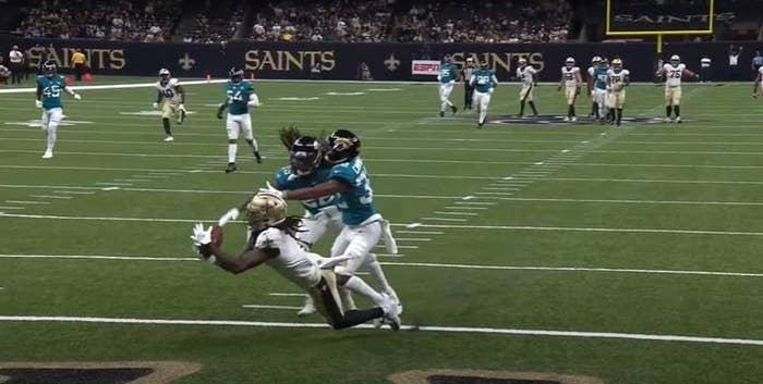 Saints player makes diving catch