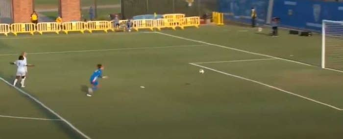 Soccer player chases down soccer ball