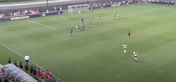 Sarah Griffith dribbles soccer ball toward goal