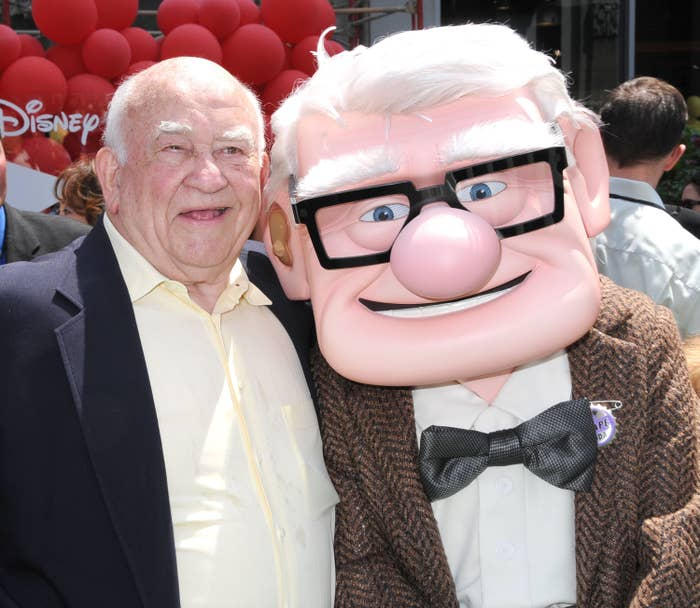 Ed smiling next to a person wearing the cartoon head of Ed's character, Carl Fredricksen, from Up