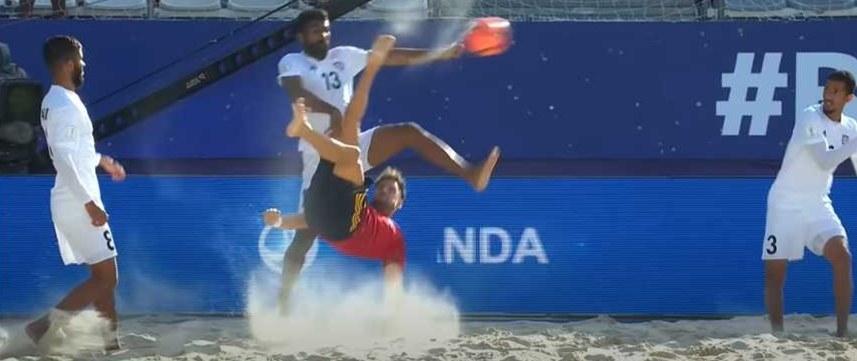 Beach soccer player executes bicycle kick