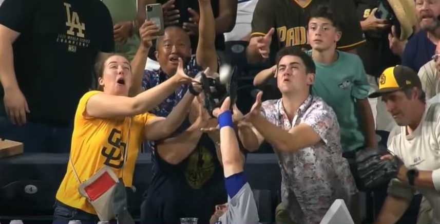 Baseball player reaches into crowd to steal the ball