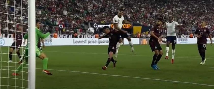 Miles Robinson heads soccer ball toward goal