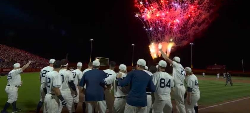 Teammates wait for Tim Anderson at home plate while fireworks explode