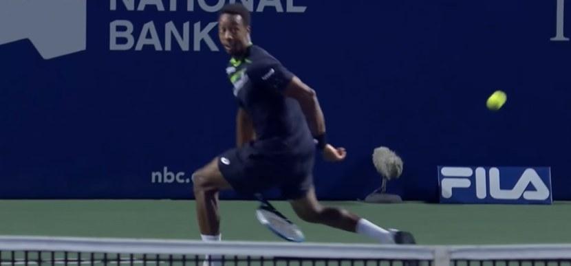 Gaël Monfils hits tennis ball between his legs