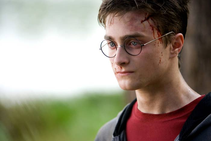 Radcliffe as Harry Potter with blood running down his temple