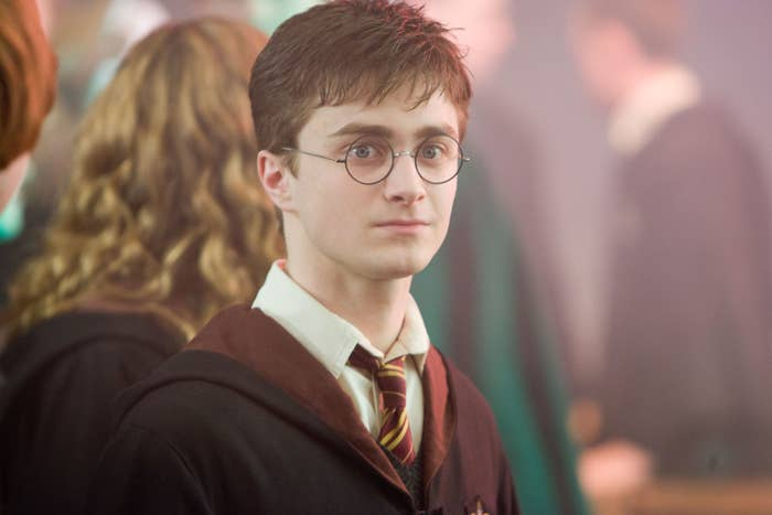Daniel Radcliffe stares into the distance as Harry Potter