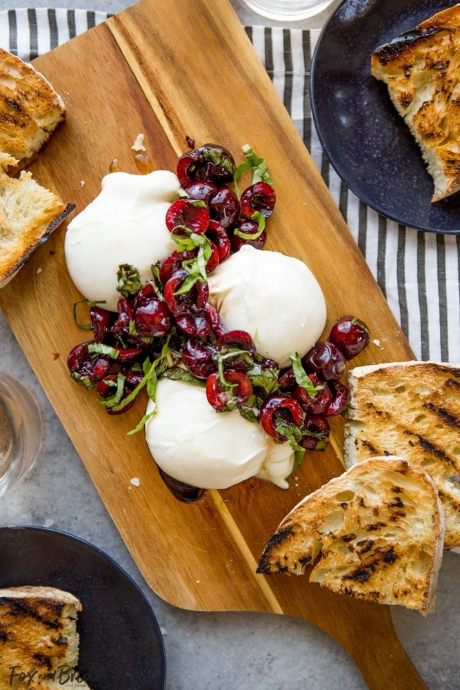 Burrata with cherries and toasted sourdough.