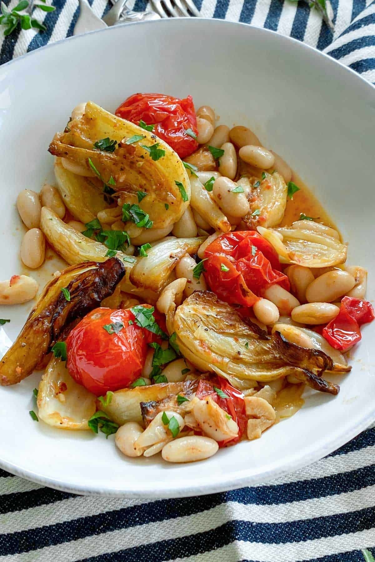 Roasted fennel with white beans and tomatoes.