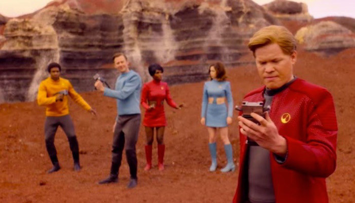 five people in space outfits walk through a space planet, maybe mars, and they're lost