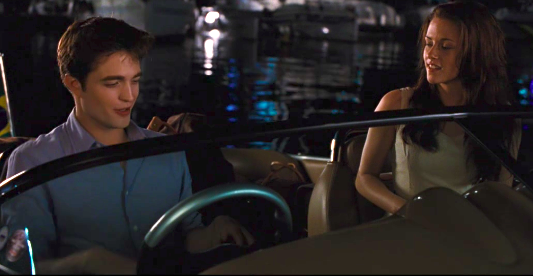 Edward Cullen driving a boat
