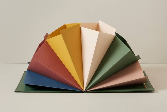 The colourful file folder open to show off all the compartments