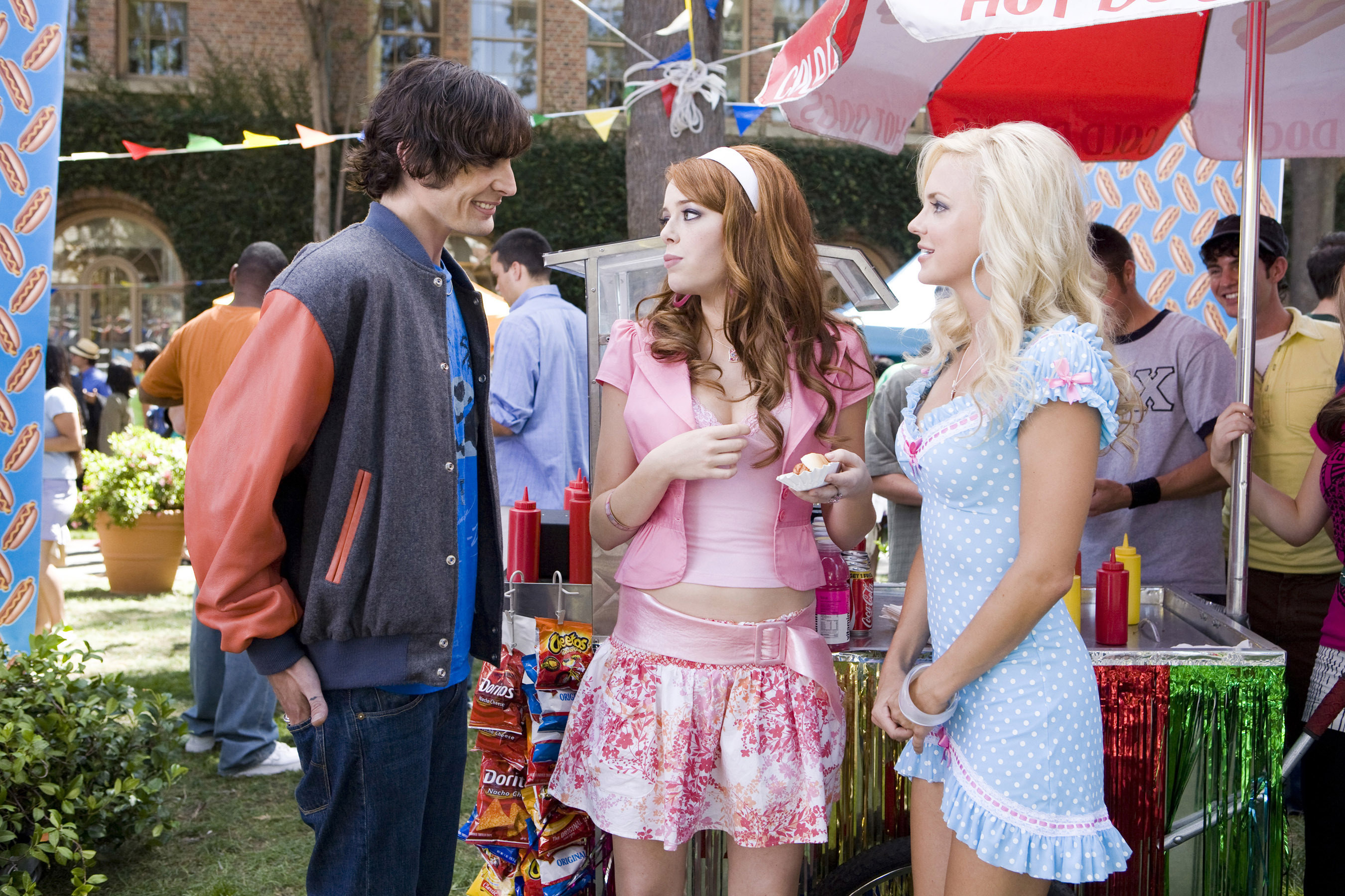 Tyson Ritter talks to Emma Stone and Anna Faris at a party