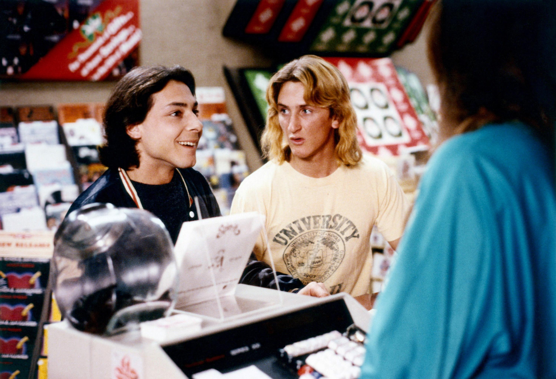 Robert Romanus and Sean Penn check out at a record store