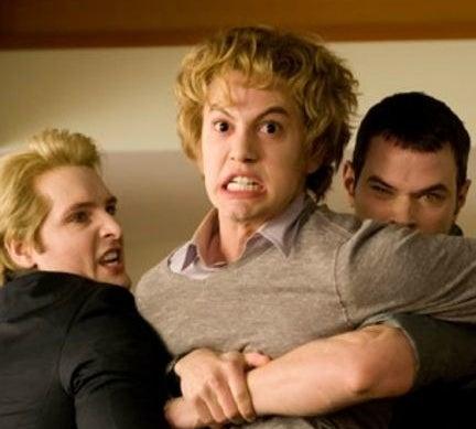 Carlisle and Emmett holding Jasper back before he kills Bella