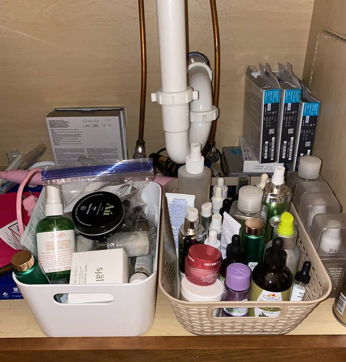 Photo of tons of makeup products under sink.