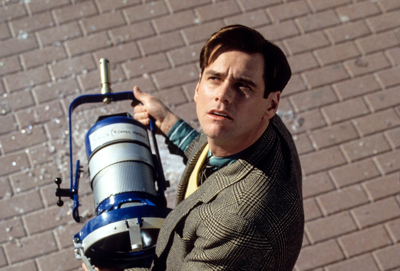 Jim Carrey holds a broken stage light
