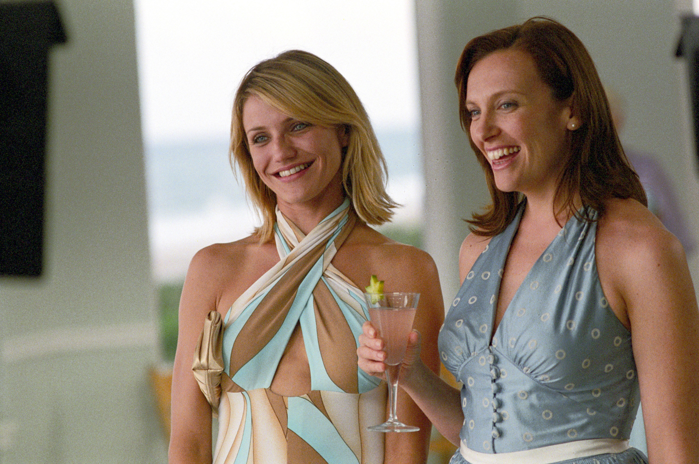Cameron Diaz and Toni Collette hold drinks at a party