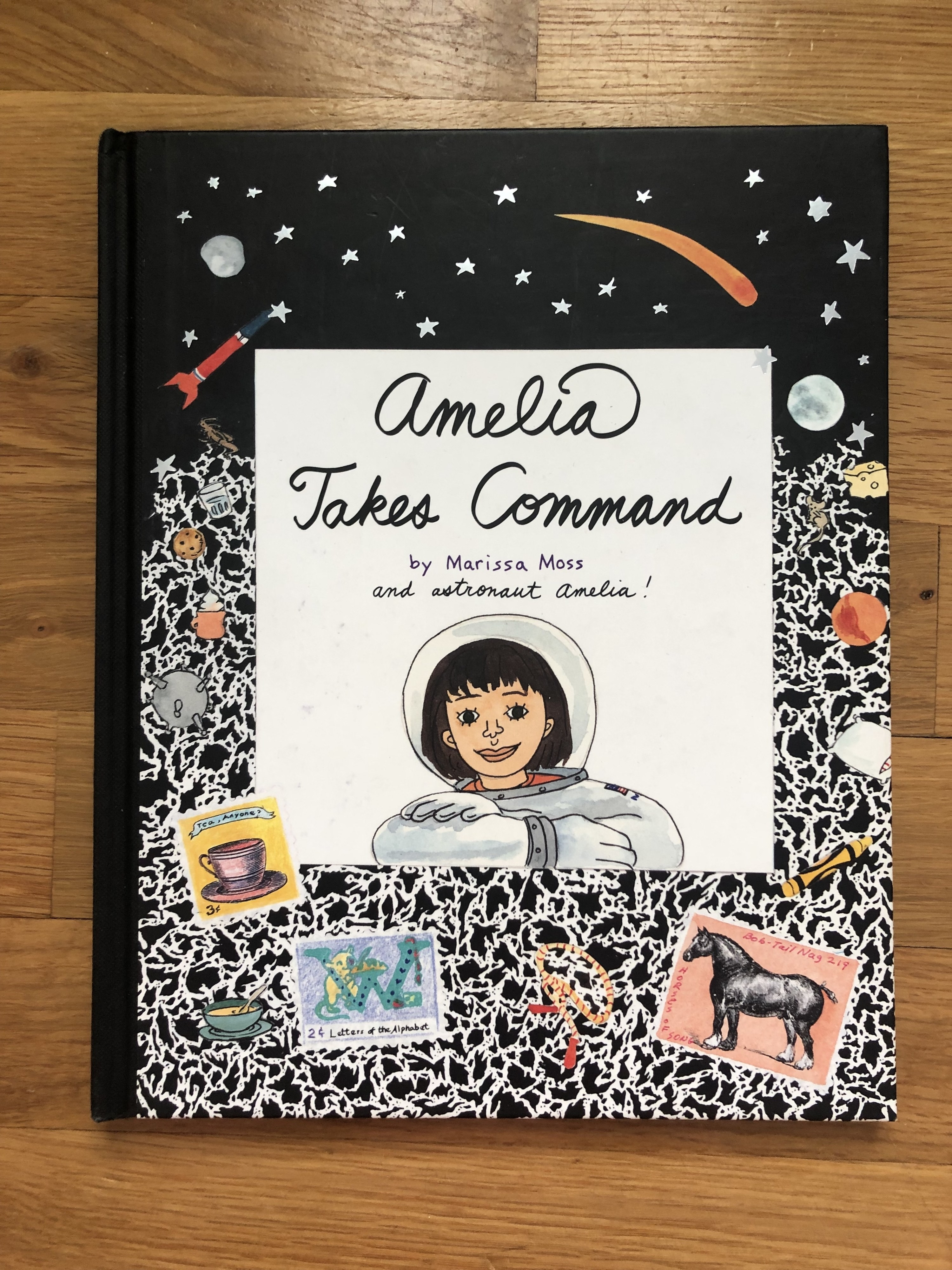 """Composition notebook cover for """"Amelia Takes Command"""""""