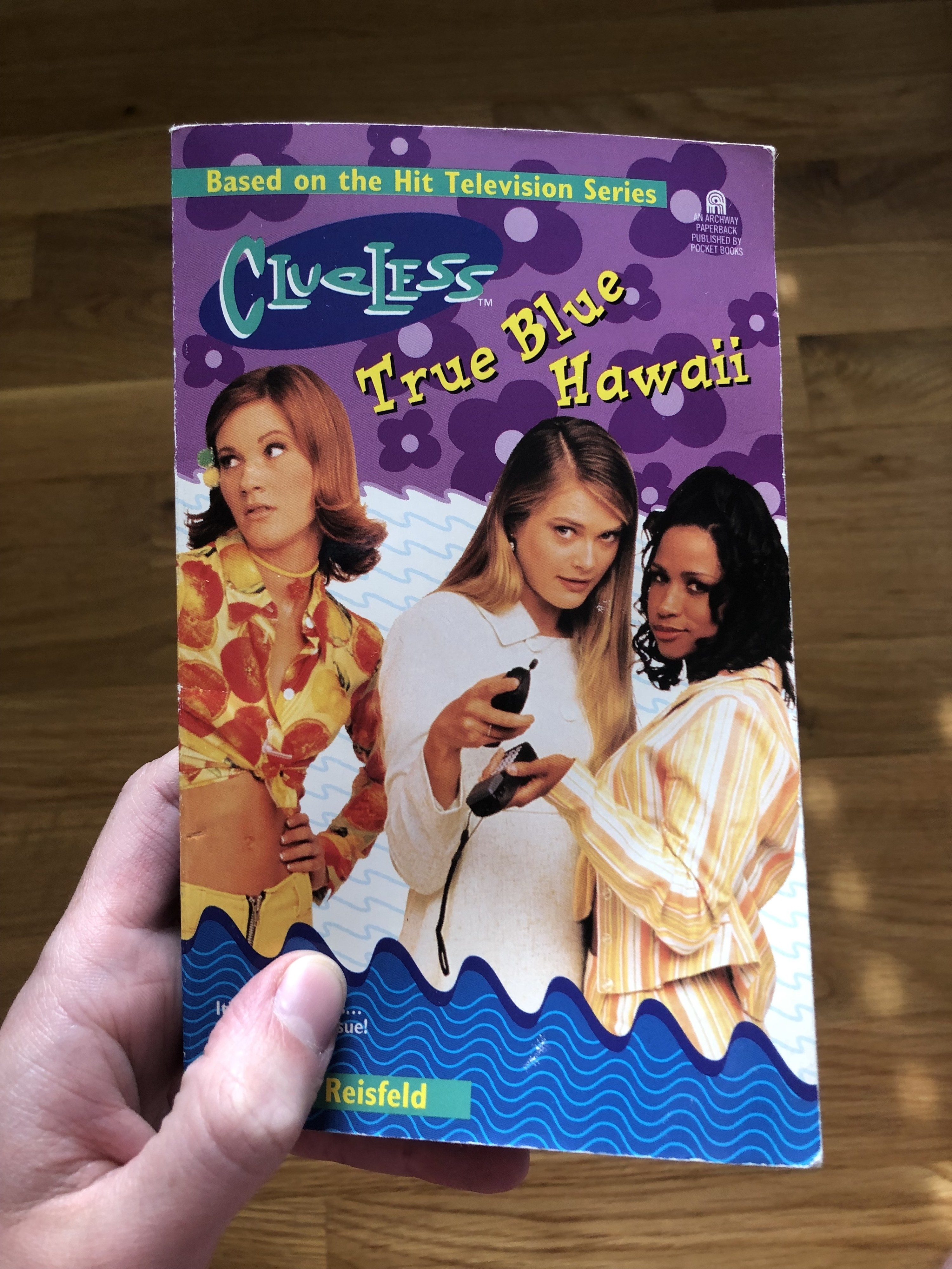 """""""Clueless"""" TV series actors posing for the book cover, titled: """"Clueless: True Blue Hawaii"""""""