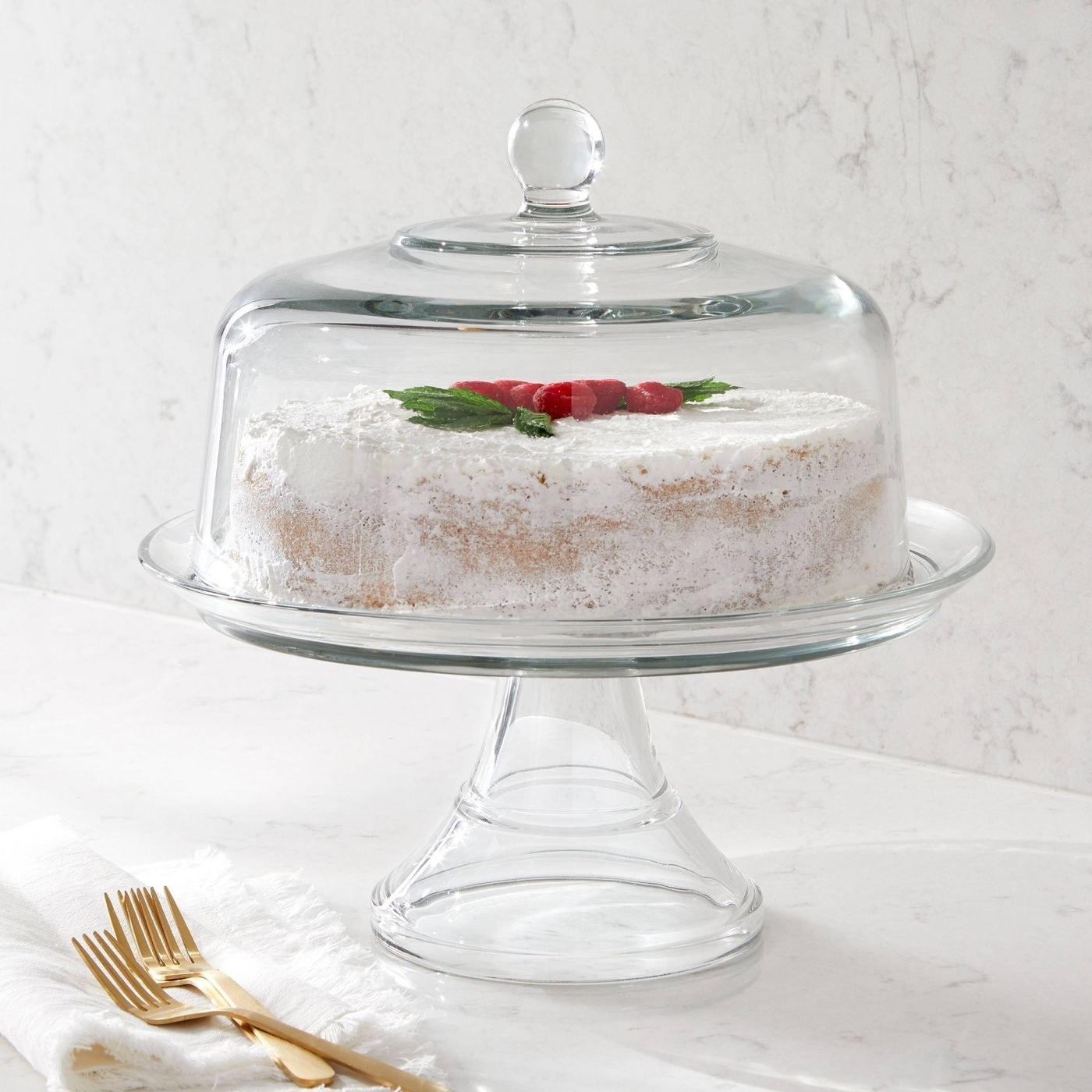 the glass cake stand with a cake inside
