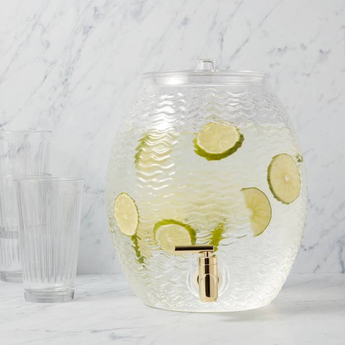 the dispenser filled with limeade on a counter