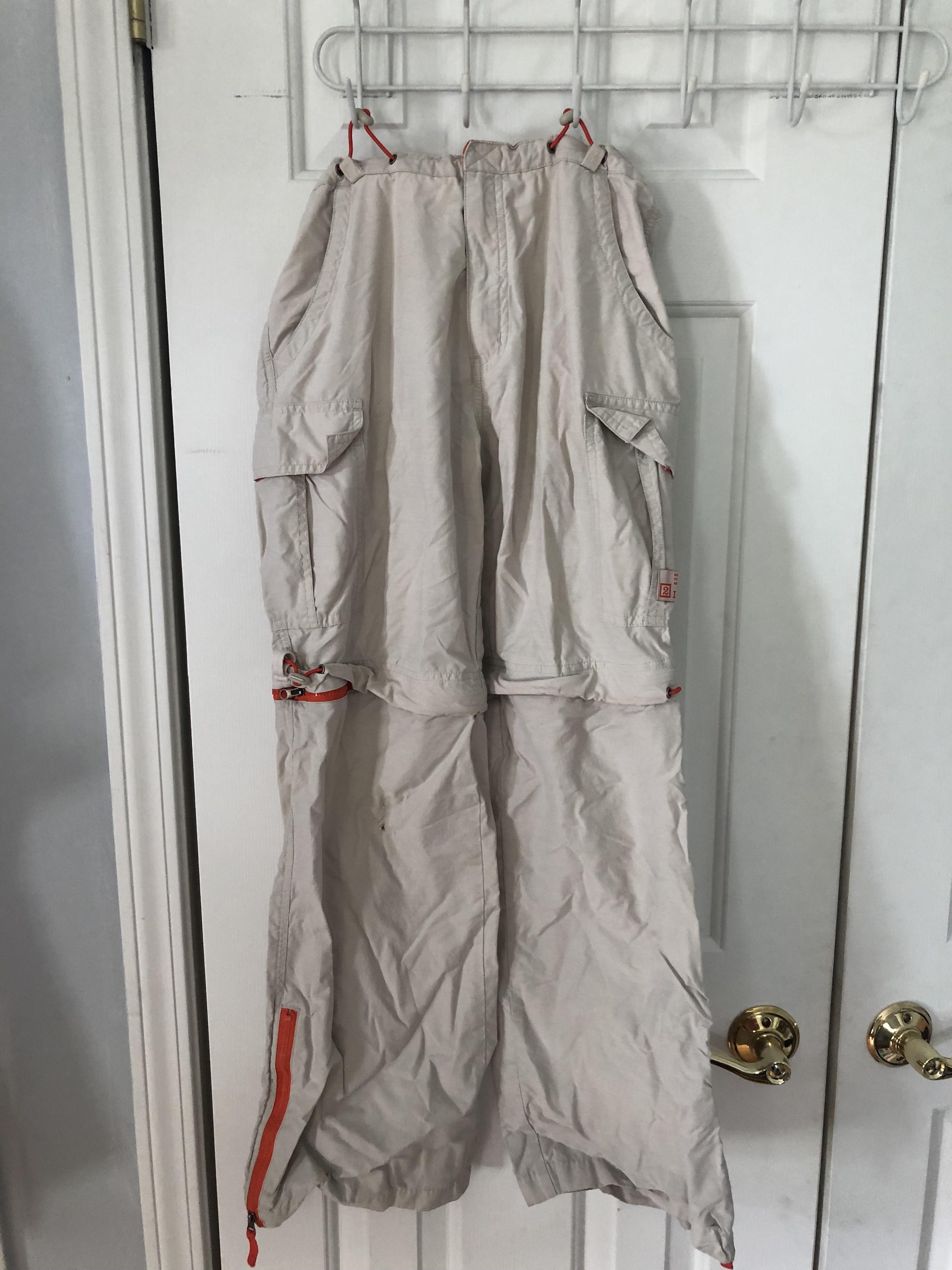 Zip-off pants hanging from a closet door