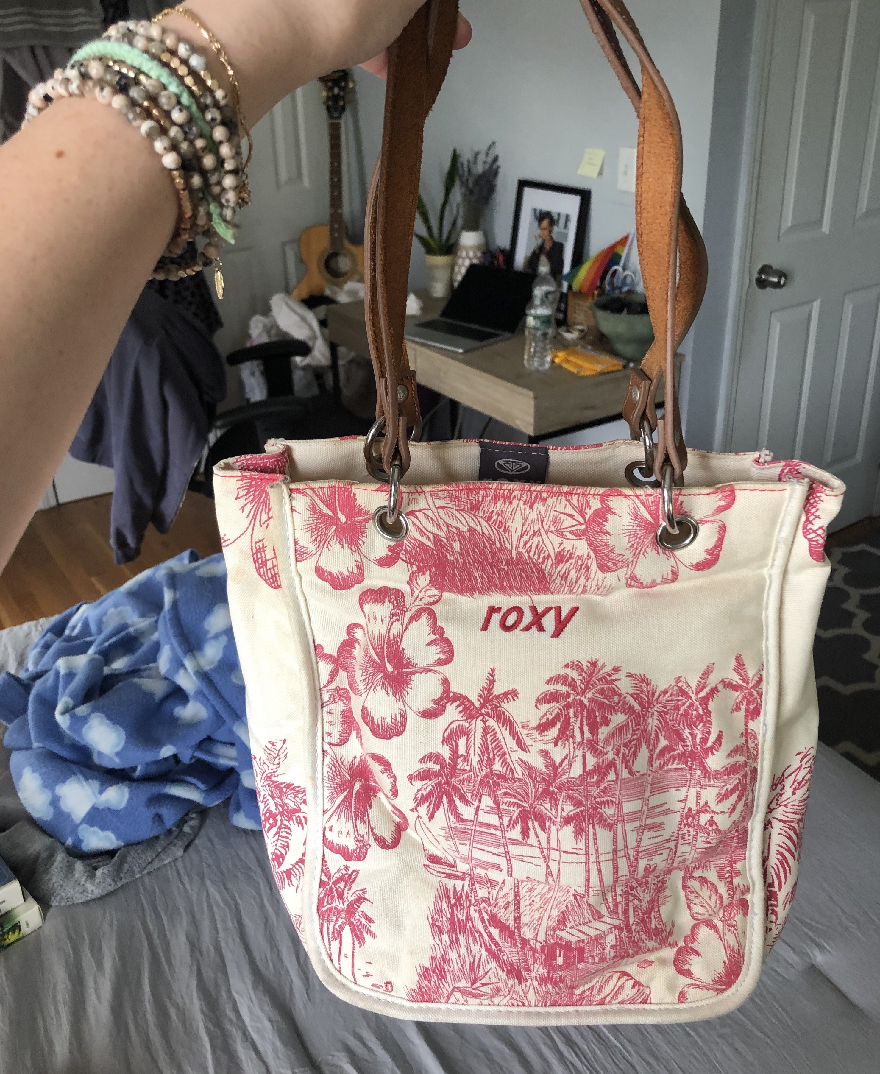 Me holding up the Roxy purse in my childhood bedroom