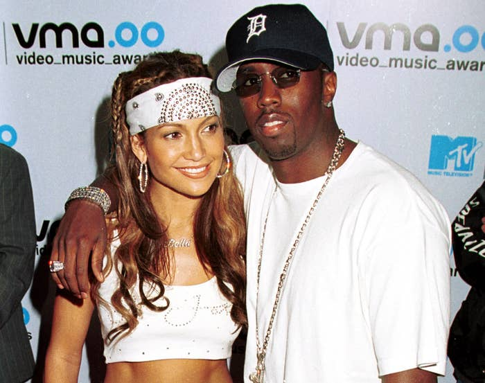 Diddy wears a white t-shirt while Jennifer matches in a white crop top and white bandana around her head