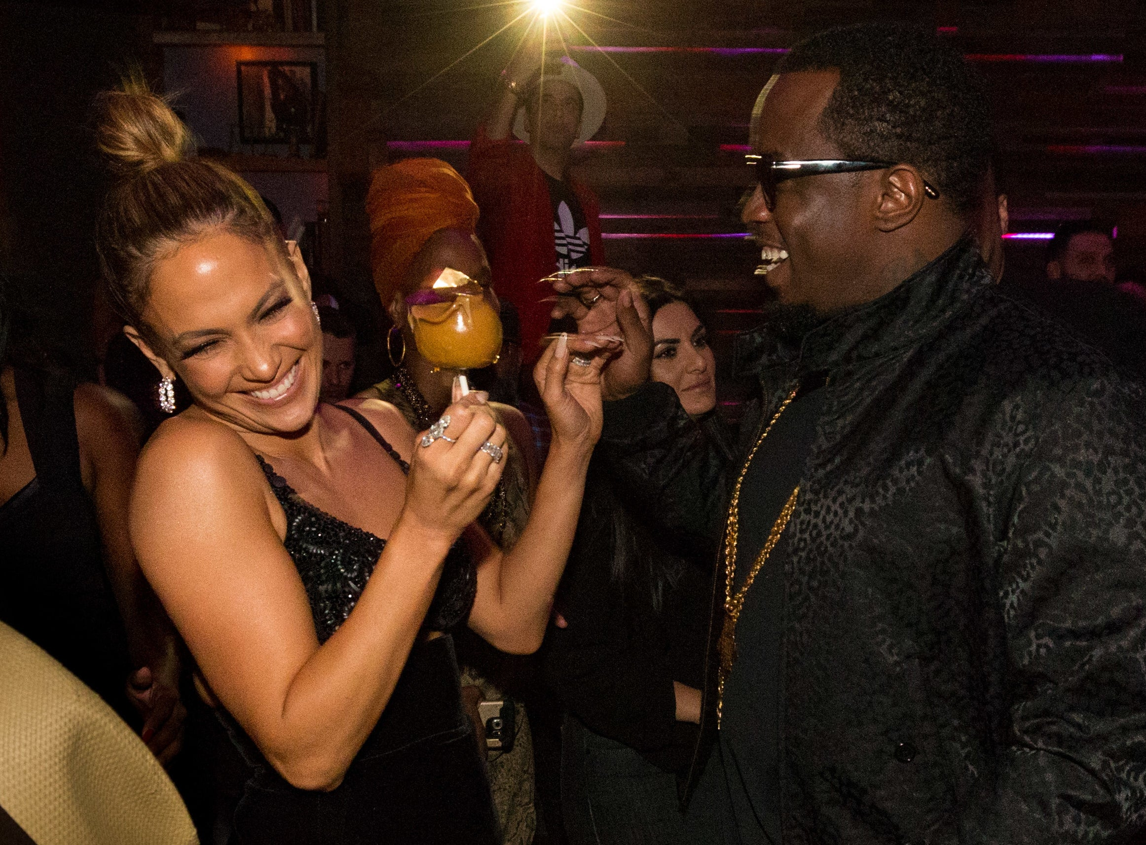 Jennifer laughs while Diddy stands across from her at a recent event