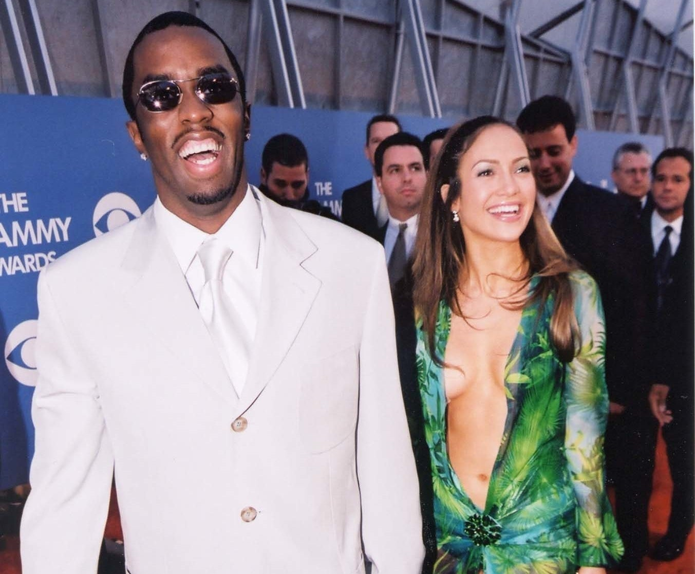Jennifer and Diddy smile and hold hands while arriving at an award show