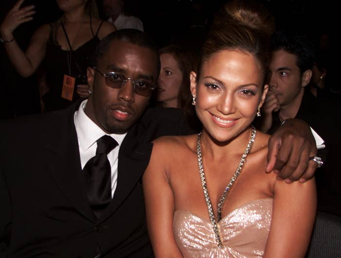 Diddy puts his arm around Jennifer while sitting at an award show
