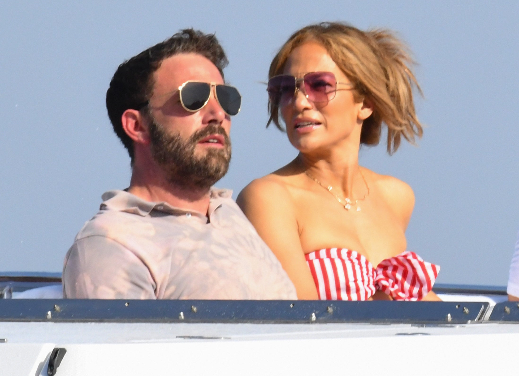 Jennifer sits on a yacht with Ben recently