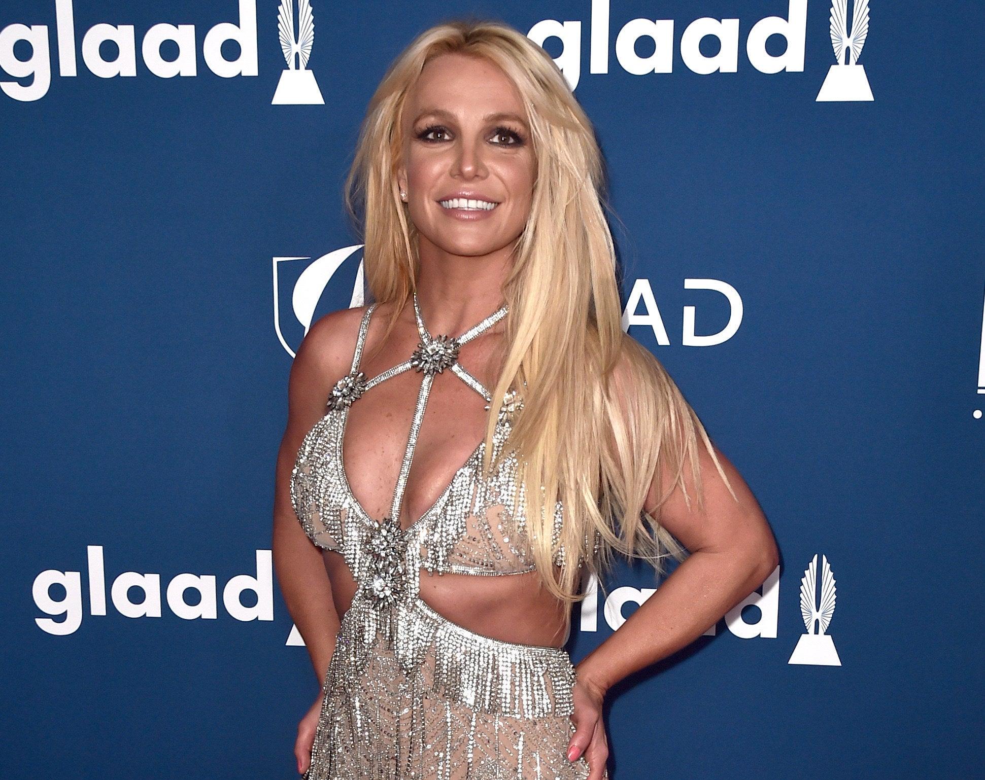 Britney wears a shimmering diamond encrusted dress