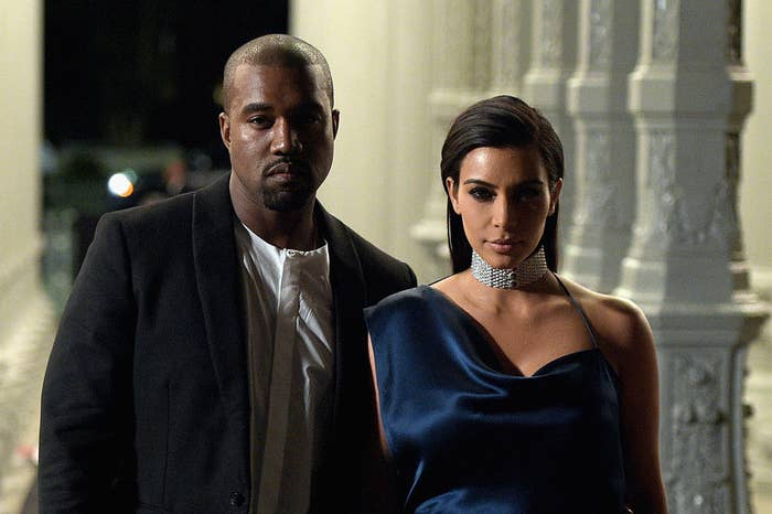 Kanye and Kim, both looking serious, stand together at the 2014 LACMA Art + Film Gala
